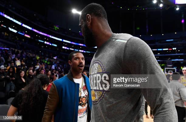 Michael B Jordan greets LeBron James of the Los Angeles Lakers after the Los Angeles Lakers and Milwaukee Bucks basketball game at Staples Center on...