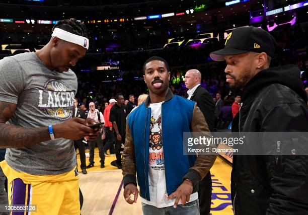 Michael B Jordan poses next to Dwight Howard of the Los Angeles Lakers after the basketball game against Milwaukee Bucks at Staples Center on March 6...