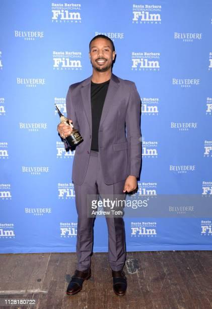 Michael B Jordan poses with his award during Belvedere Vodka Celebrates Michael B Jordan's Cinema Vanguard Award at the 34th annual Santa Barbara...