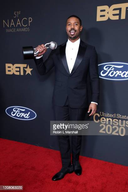Michael B Jordan poses with the Outstanding Actor in a Motion Picture award for Just Mercy the 51st NAACP Image Awards Presented by BET at Pasadena...