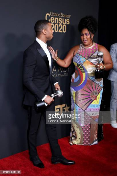 Michael B Jordan poses with the Outstanding Actor in a Motion Picture award for Just Mercy and Lizzo poses with the Entertainer of the Year award the...