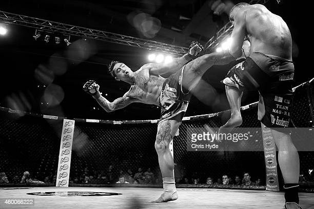 Michael Badato of Australia kicks Yohan Lidon of France during a CMT5 Cage Muay Thai Championship Fight at the Logan Metro Sports Centre on December...