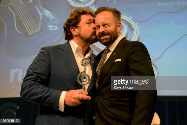 Michael Ball and Alfie Boe winners of the PPL Classical Award on stage during the Nordoff Robbins' O2 Silver Clef Awards ceremony at Grosvenor House...
