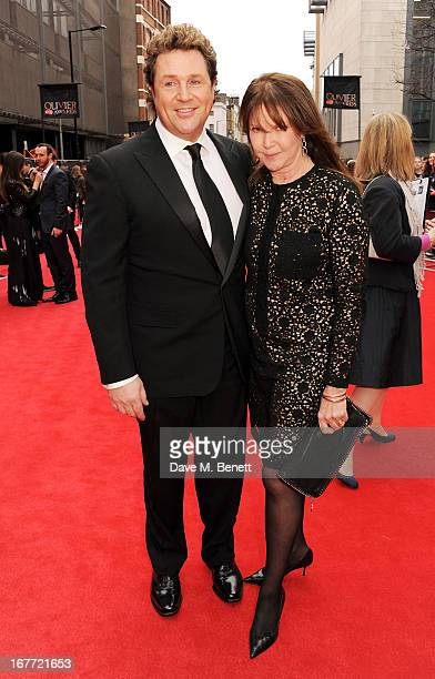 Michael Ball and Cathy McGowan arrive at The Laurence Olivier Awards 2013 at The Royal Opera House on April 28 2013 in London England