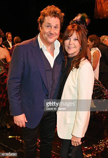 Michael Ball and Cathy McGowan pose onstage at The Phantom Of The Opera 30th anniversary charity gala performance in aid of The Music in Secondary...