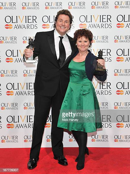 Michael Ball and Imelda Staunton pose with their awards at The Laurence Olivier Awards The Royal Opera House on April 28 2013 in London England