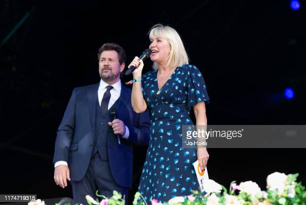 Michael Ball and Nicki Chapman on stage during BBC Proms In The Park 2019 at Hyde Park on September 14 2019 in London England