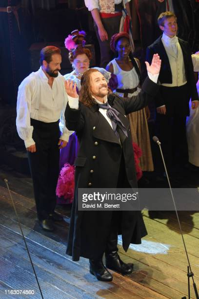 """Michael Ball bows at the curtain call during the press night performance of """"Les Miserables: The Staged Concert"""" at The Gielgud Theatre on August 21,..."""