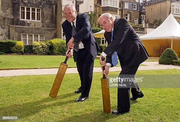Michael Ball Chairman of the Bradman Foundation and former Prime Minister of Australia John Howard AC pose with two of the 'Bradman Cricket Bats' at...