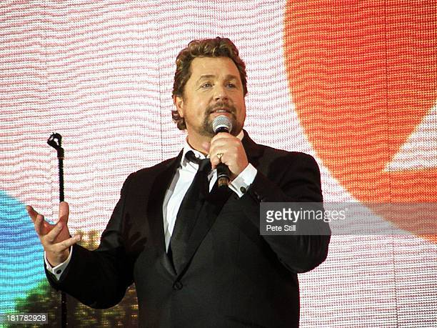 Michael Ball introduce an artiste to the stage at the BBC Radio 2 Festival In A Day concert at Hyde Park on September 8, 2013 in London, England.