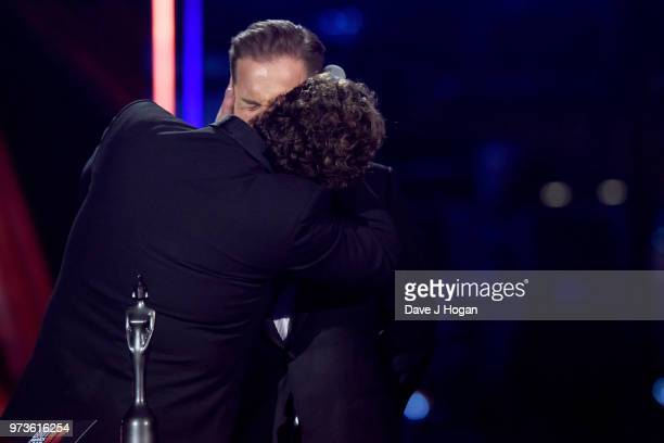 Michael Ball kisses Alfie Boe during the 2018 Classic BRIT Awards held at Royal Albert Hall on June 13 2018 in London England