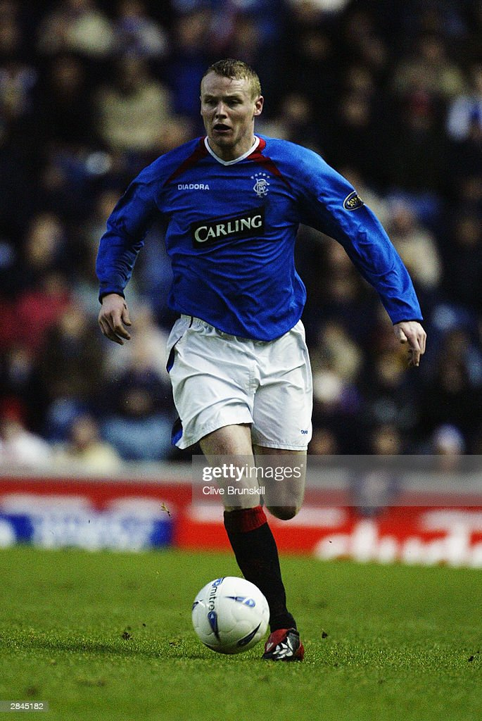 Michael Ball of Rangers running with the ball during the Bank of Scotland Scottish Premier League match between Rangers and Hearts on December 20, 2003 at Ibrox in Glasgow, Scotland. Rangers won the match 2-1.