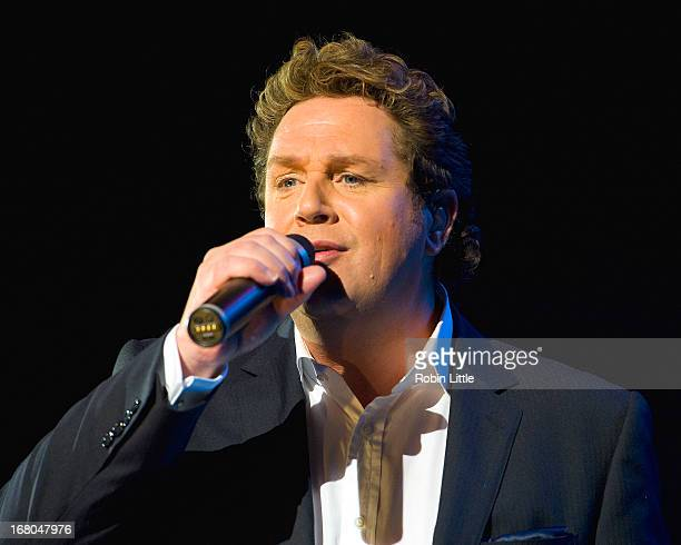 Michael Ball performs on stage at Hammersmith Apollo on May 4, 2013 in London, England.