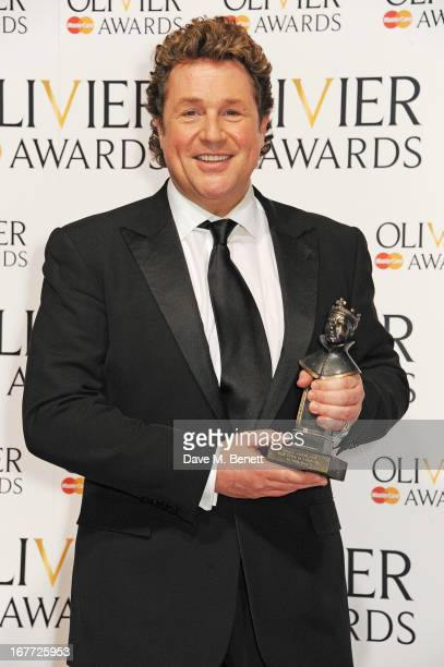 Michael Ball winner of Best Actor in a Musical poses in the press room at The Laurence Olivier Awards 2013 at The Royal Opera House on April 28 2013...