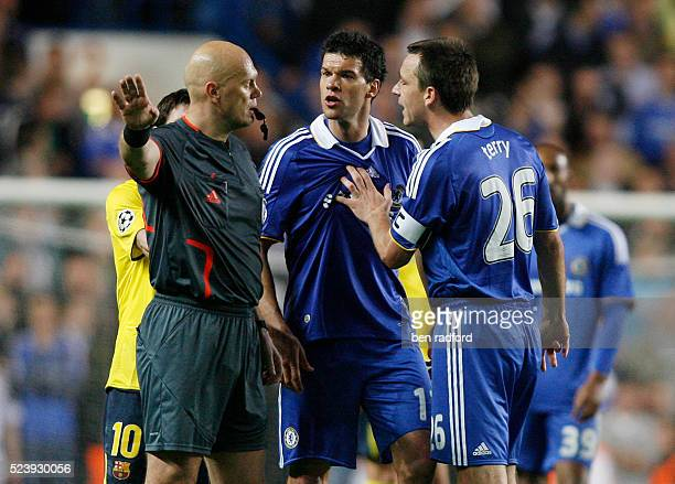 Michael Ballack and Captain John Terry of Chelsea complain to Referee Tom Henning Ovrebo during the UEFA Champions League Semi -Final 2nd Leg match...