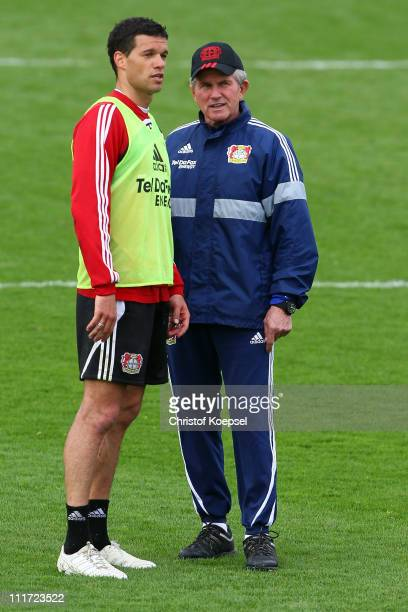 Michael Ballack and head coach Jupp Heynckes talk during a Bayer Leverkusen training session at BayArena training ground on April 6 2011 in...