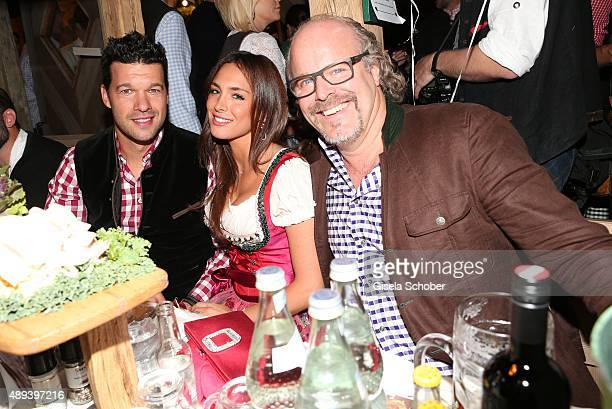 Michael Ballack and his girlfriend Natacha Tannous and Peter Olsson attend the Almauftrieb during the Oktoberfest 2015 at Kaeferschaenke beer tent on...