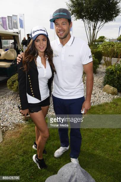 Michael Ballack and his girlfriend Natacha Tannous attend the 10th GRK Golf Charity Masters on August 19, 2017 in Leipzig, Germany.