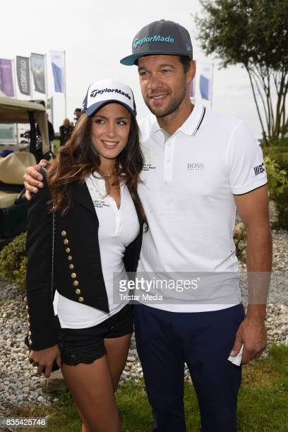 Michael Ballack and his girlfriend Natacha Tannous attend the 10th GRK Golf Charity Masters on August 19 2017 in Leipzig Germany