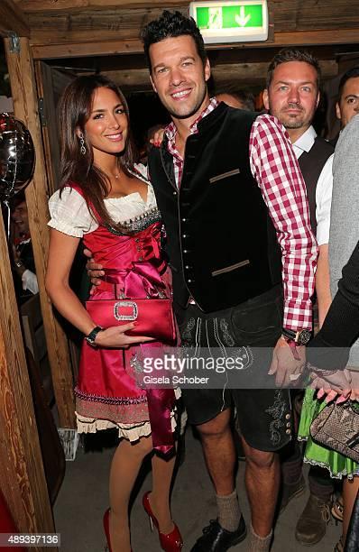 Michael Ballack and his girlfriend Natacha Tannous attend the Almauftrieb during the Oktoberfest 2015 at Kaeferschaenke beer tent on September 20...