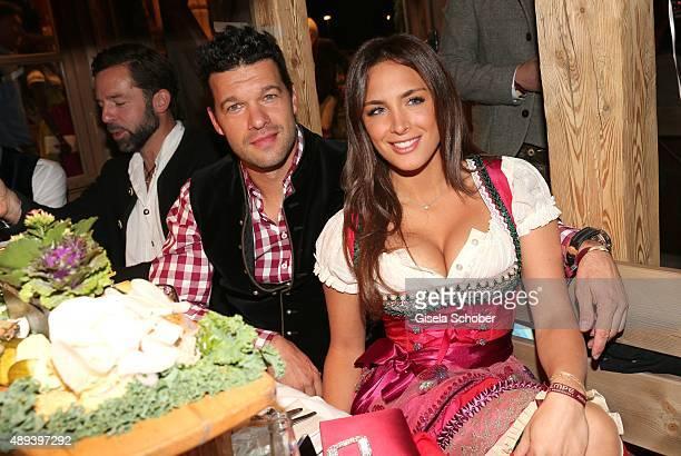 Michael Ballack and his girlfriend Natacha Tannous attend the Almauftrieb during the Oktoberfest 2015 at Kaeferschaenke beer tent on September 20,...