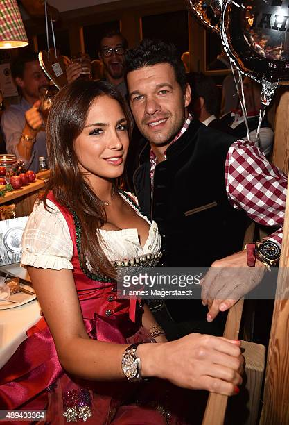 Michael Ballack and his girlfriend Natacha Tannous attend the Almauftrieb during the Oktoberfest 2015 at Kaefer Tent on September 20 2015 in Munich...