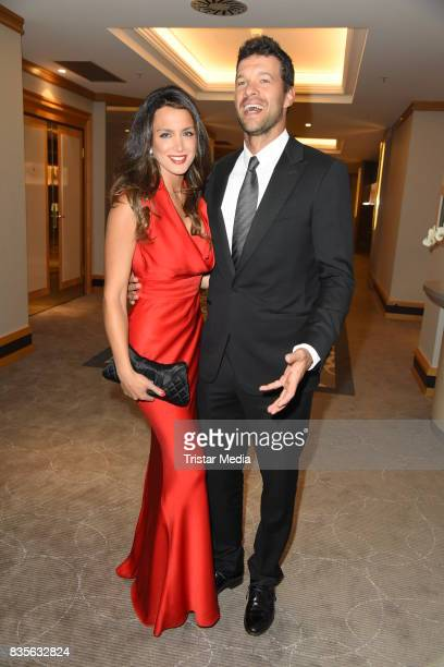 Michael Ballack and his girlfriend Natacha Tannous attend the GRK Golf Charity Masters evening gala on August 19, 2017 in Leipzig, Germany.