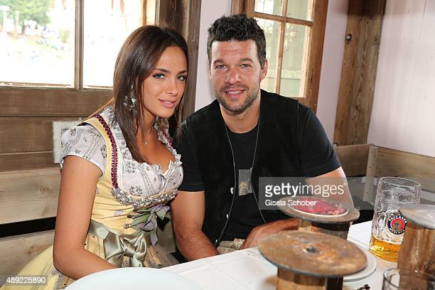 Michael Ballack and his girlfriend Natacha Tannous during the Oktoberfest 2015 Opening at Kaeferschaenke beer tent at Theresienwiese on September 19...