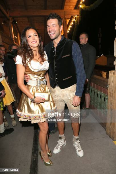 Michael Ballack and his girlfriend Natacha Tannous during the 'Almauftrieb' as part of the Oktoberfest 2017 at Kaeferschaenke Tent on September 17...