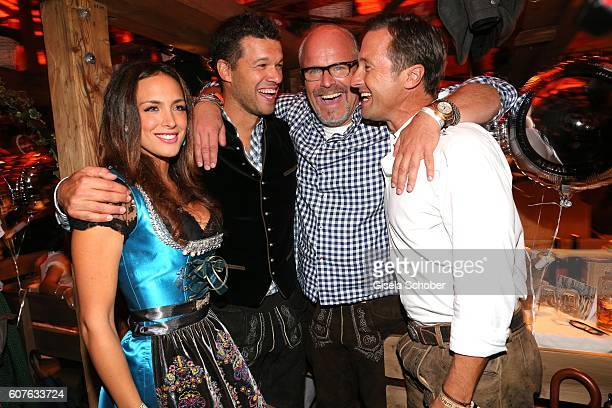 Michael Ballack and his girlfriend Natascha Tannous Peter Olsson and Norbert Dobeleit during the 'Almauftrieb' as part of the Oktoberfest 2016 at...
