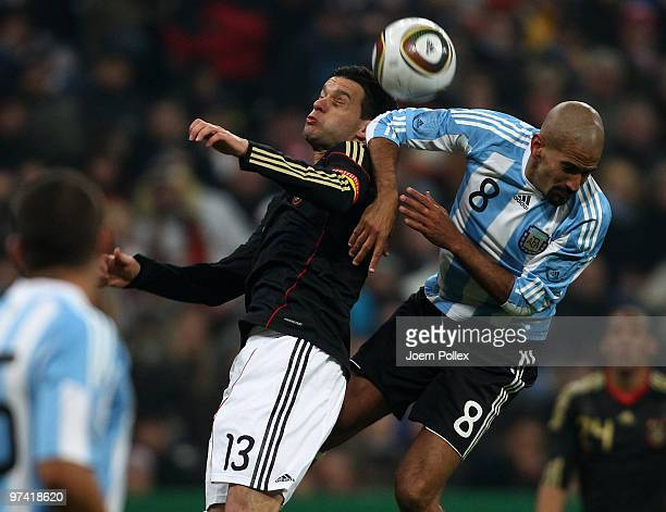 Michael Ballack and Juan Sebastian Veron of Germany and Lionel Messi Friendly match between Germany and Argentina at the Allianz Arena on March 3...