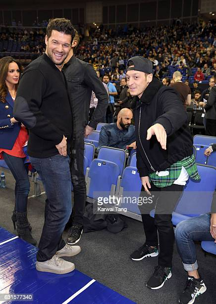 Michael Ballack and Mesut Ozil attend the Denver Nuggets v Indiana Pacers match as part of the NBA Global Games London 2017 at The O2 Arena on...