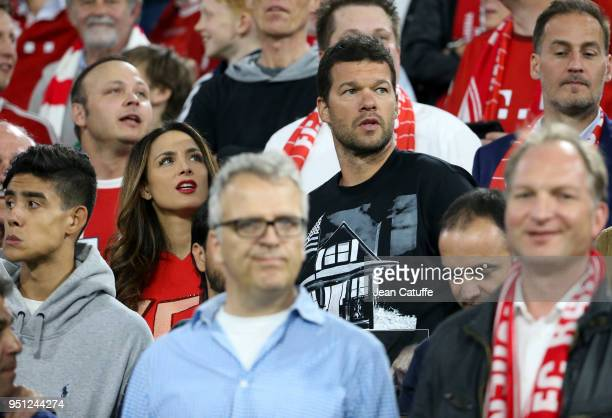 Michael Ballack and Natacha Tannous attend the UEFA Champions League Semi Final first leg match between Bayern Muenchen and Real Madrid at the...