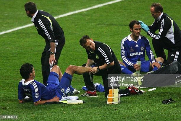 Michael Ballack and Ricardo Carvalho of Chelsea receive medical treatment in the short break before the first period of extra time during the UEFA...