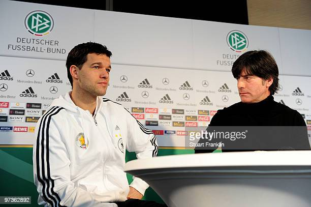 Michael Ballack captain of Germany and Joachim Loew head coach of Germany are seen during a press conference for the German national football team on...