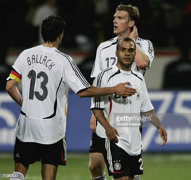 Michael Ballack David Odonkor and Per Mertesacker of Germany look thoughtful after the 22 draw of the International Friendly match between Germany...