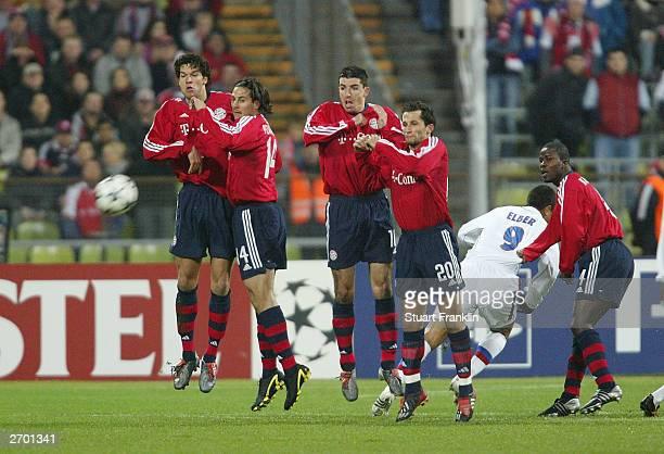 Michael Ballack Hasan Salihamidzic Roy Makaay Willy Sagnol and Ze Roberto of Bayern attempt to block the shot of Juninho of Lyon during the UEFA...