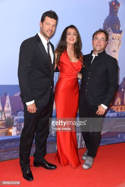 Michael Ballack, his girlfriend Natacha Tannous and Jan Josef Liefers attend the GRK Golf Charity Masters evening gala on August 19, 2017 in Leipzig,...