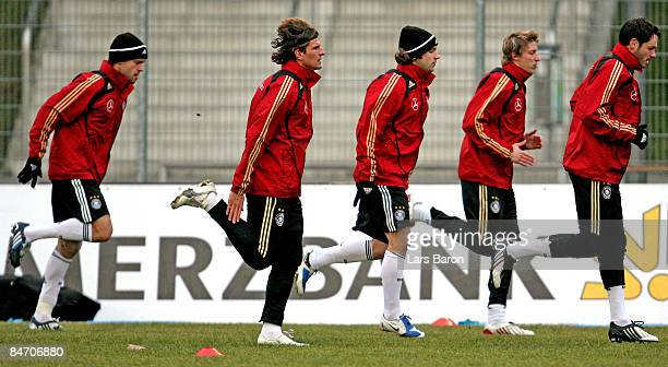 Michael Ballack Mario Gomez Torsten Frings Stefan Kiessling and Heiko Westermann warm up during a german national team training session at the Kleine...