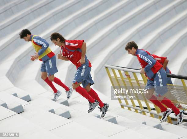 Michael Ballack Martin Demichelis and Sebastian Deissler run up the stairs of the Al Wasel Stadium during a Bayern Munich training session at the...