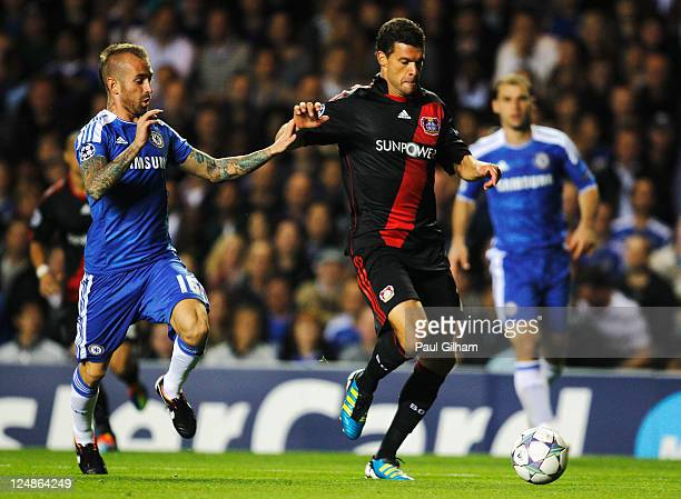 Michael Ballack of Bayer Leverkusen is challenged by Raul Meireles of Chelsea during the UEFA Champions League group E match between Chelsea FC and...