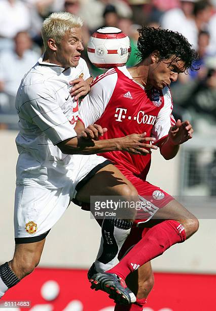 Michael Ballack of Bayern Munich goes up for the ball with Alan Smith of Manchester United during the World Series between Manchester United and...
