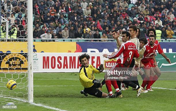 Michael Ballack of Bayern Munich scores with a header for the second goal during the friendly match between Persepolis Tehran and Bayern Munich at...