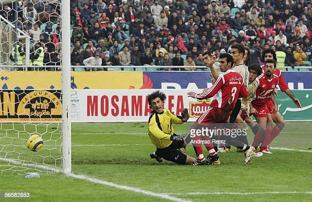 Michael Ballack of Bayern Munich scores with a header for the second goal during the friendly match between Persepolis Teheran and Bayern Munich at...
