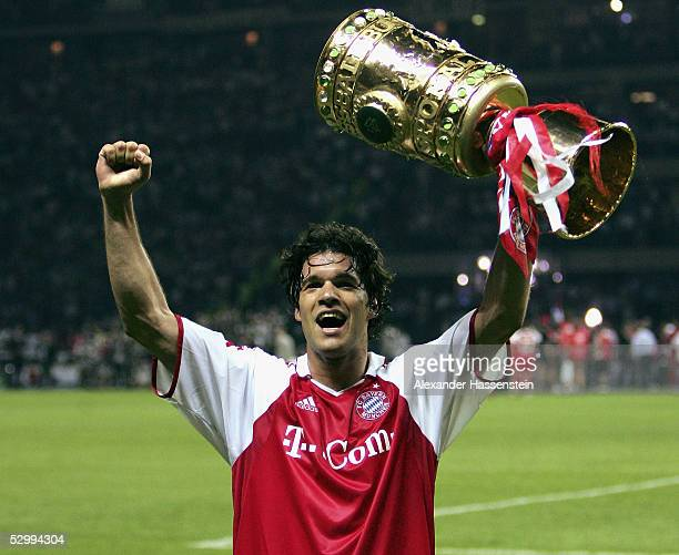 Michael Ballack of Bayern Munich team ecstatically holds a replica of the Trophy after winning the German Football Federations Cup Final between FC...