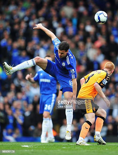Michael Ballack of Chelsea battles with Ben Watson of Wigan Athletic during the Barclays Premier League match between Chelsea and Wigan Athletic at...