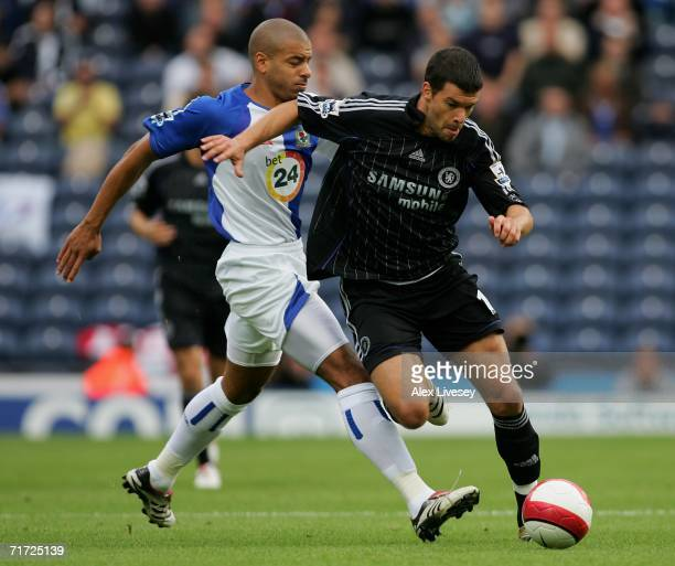 Michael Ballack of Chelsea is challenged by Steven Reid of Blackburn Rovers during the Barclays Premiership match between Blackburn Rovers and...