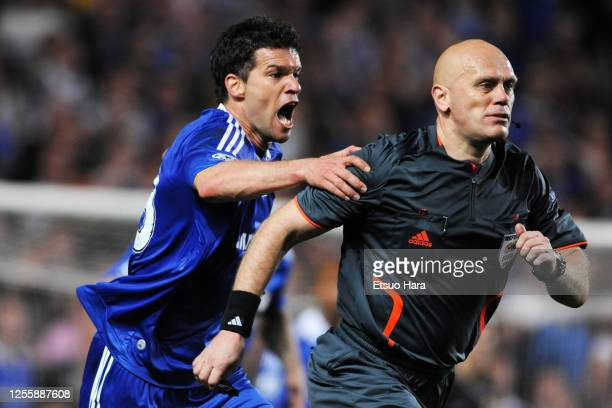 Michael Ballack of Chelsea protests to referee Tom Henning Ovrebo during the UEFA Champions League semi final second leg match between Chelsea and...