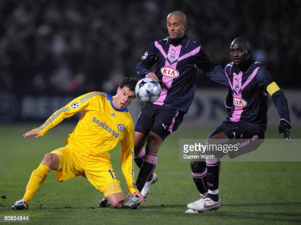 Michael Ballack of Chelsea takes on Wendel and Alou Diarra of Bordeaux during the Group A UEFA Champions League match between Bordeaux and Chelsea at...