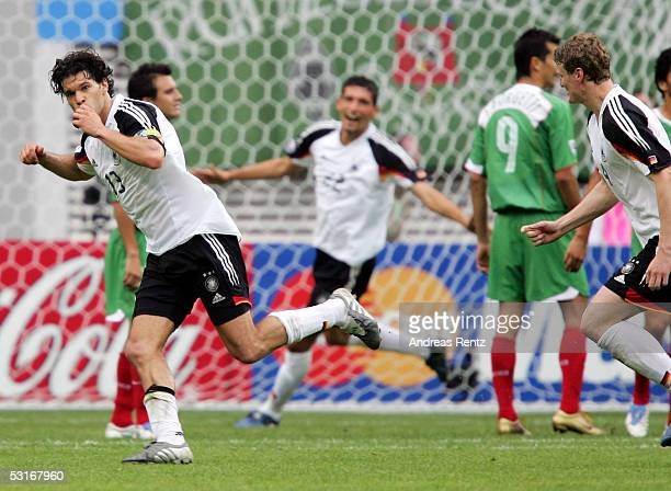 Michael Ballack of Germany celebrates after seventh goal with Kevin Kuranyi and Robert Huth during the game between Germany and Mexico for the third...